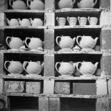 Cheap Chinaware Saucers  Cups  Teapots  Etc Standing on Racks in Pottery of the Hall China Co