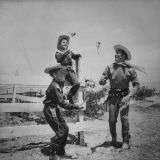 Actor Kirk Douglas in Western Outfit Showing His 2 Sons Some Fancy Gun Handling at Dude Ranch
