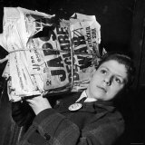 Boy from the Madison Square Boys' Club Carrying a Bundle of Newspapers After Attack on Pearl Harbor
