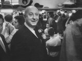 Designer Christian Dior Standing in Dressing Room at Paris Salon Before Showing of His Collection