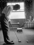 Golfer Ben Hogan Practicing Putting in His town house with Wife Valerie Watching from Armchair