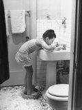 Child Star Margaret O'Brien Brushing Her Teeth