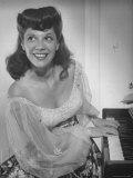 Singer Dinah Shore at Piano