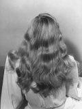 Actress Veronica Lake Posing with Her Glorious  Wavy Honey Blond Hair Cascading over Her Shoulders
