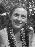 Actress Joan Fontaine Sporting Pigtails and Her Natural Freckles in Yard at Home
