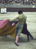 "Bullfighter Manuel Benitez  Known as ""El Cordobes "" Sweeping His Cape Aside the Charging Bull"