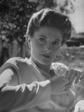Actress Joan Fontaine Wearing Film Makeup and a Pompadour Hairdo  Relaxing in Garden at Home