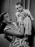 Singer and Actress Judy Garland Holding Her Darling Baby Daughter Liza at Home