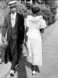 African American Sporting His Sunday Finery Glancing at Frilly Frocked Girl Passing Him on Street