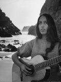 Folk Singer Joan Baez on the Beach with Guitar Near Her Home