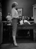 Actress Marilyn Monroe Talking Sexily on Phone While Displaying Her Talents for Producer Jerry Wald