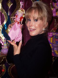 Actress Barbara Eden Holding Up Jeannie Doll