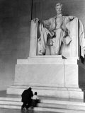 Black Man and Small Boy Kneeling Prayerfully on Steps on Front of Statue in the Lincoln Memorial