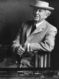 Smiling Architect Frank Lloyd Wright Seated While Wearing Hat