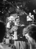 Bandleader Lawrence Welk Playing Accordion Amidst Cameramen on the Set of Weekly TV Show