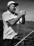 Author Ernest Hemingway at Wheel of Fishing Boat During Fishing Tournament