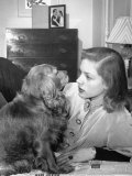 Actress Lauren Bacall Chatting with Her Cocker Spaniel Dog in Her Suite at Gotham Hotel