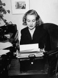 Actress Carole Lombard Typing While Holding Pencil Firmly in Her Mouth