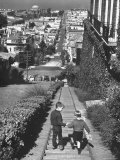 Two Boys Walking Hand in Hand Down Long Stairway with view of Bay from Pacific Heights
