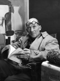 Architect Le Corbusier Sitting in Chair and Holding Book in Hands