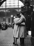 Soldier Embracing Girlfriend While Saying Goodbye in Pennsylvania Station Before Returning to Duty