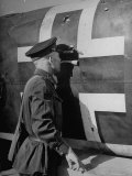 Russian Soldier Peering Through Hole in Fuselage of German Dive Bomber During Air Raid on the City