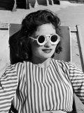 "Model Stephanie Nikashian Sporting Sunglasses with ""Seashell Rims"" While Lounging at Beach"