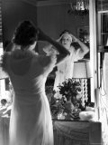 Mrs Elizabeth Arden Graham Viewing Herself in Bedroom Mirror