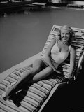 Actress Marie McDonald Posing in Chair by Swimming Pool