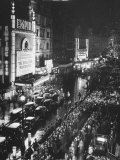 People Waiting in Front of the Brightly Lighted Empire Theatre for the Royal Film Performance