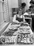Cornell's Home Economics Student Lois Schumacher prepares food  Classmates Help with Decorations