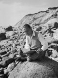 Author W Somerset Maugham Reading While Sitting on the Rocky Shore During His Summer on Cape Cod