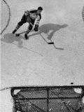 Ice Hockey Player Jean Beliveau  Slamming the Puck Into the Goal While He Slides Down the Ice