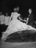 Whirling Hoop of Plastic Flaring Out Ruffled Skirt on Joan Davidson as She Dances with Frank Turner