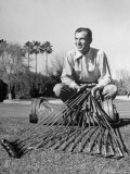 Golfer Ben Hogan with Golf Clubs