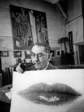 "Painter Photographer Man Ray Holding Up ""Lips"" Print  Winking at Camera and Smoking a Pipe"