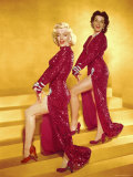 Actresses Marilyn Monroe and Jane Russell Wearing Gowns Designed by Travilla Pose for Publicity