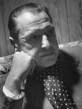 Author Somerset Maugham Sitting on Couch and Leaning Head on Knuckles