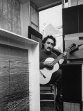 Venezuelan Kinetic Artist Raphael Jesus Soto  Playing Guitar in His Apartment