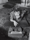 French Authoress Francoise Sagan  Laying on the Floor Typing
