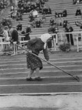 Russian Woman Preparing the Surface of the Track Sodden before Khrushev Stadium foot races