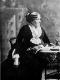 """Louisa May Alcott  Author of """"Little Women """" Seated at a Table"""