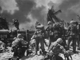 US Marines Climbing to Attack Japanese Positions During Battle to Take Tarawa Atoll