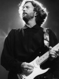 Rock Star Eric Clapton Playing His Guitar in Concert at the Meadowlands Arena
