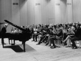 Pianist Artur Rubinstein Taking Bow Next to Grand Piano as Audience Enthusiastically Responds