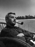 Novelist and Script Writer William Faulkner Smoking a Pipe on the Balcony of His Hotel Room