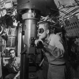 American Submarine Captain Peering Through Ship's Periscope Searching for Japanese Shipping