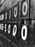Boy Running Scoreboard at Griffith Stadium During the Baseball Game Papier Photo par Hank Walker