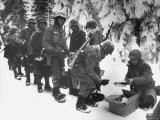 Food Being Served to American Infantrymen Curing the Battle of the Bulge