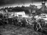 US Marines Unload Equipment and Supplies Onto the Sands of Iwo Jima from Large Coast Guard